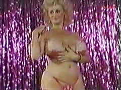 Lady Clitoris Takes Off Her Dress And Shows Off Her Boobs