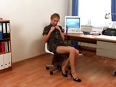 Blonde secretary strips to masturbate and to fuck herself in the office