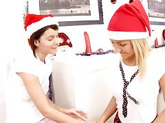 Petite horny lesbians in Santa's caps crave for pussy eating