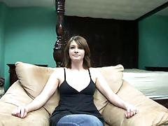 AMateur girl with milky skin pulls down her jeans showing bald pussy