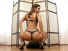 Stunning lady in a fishnet fingers herself and toys anal