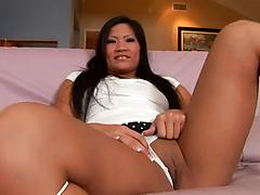 Asian stunner Christina Aguchi gives a fantastic blowjob sucks a huge dong